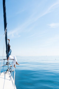 Woman on Yacht Holding a Sail at The Ocean img6 200x300